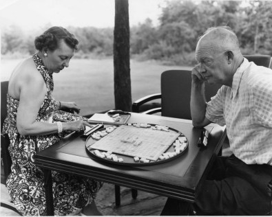 President and Mrs. Eisenhower play a game of Scrabble during a weekend vacation at Camp David, Maryland. 7/30/54. National Archives Identifier: 7330274